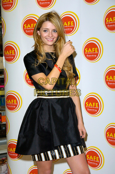MISCHA BARTON.Attends a Photocall for the Skin Cancer Awareness Campaign (SAFE) at Superdrug on Oxford Street, London, England. .April 18th, 2007.half length black dress white gold stripes striped red rubber bracelet .CAP/CAN.©Can Nguyen/Capital Pictures