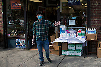 NEW YORK, NY - APRIL 25: A man wearing a face mask sells alcohol on April 25, 2020 in Queens, NY. The immigrant community in Queens has been severely affected by COVID-19, the neighborhood is overwhelmed by the number of deaths and infections during recent months, reaching the point of being considered one of the most devastated places by the desease in the U.S. and the world. (Photo by Pablo Monsalve/VIEWpress)