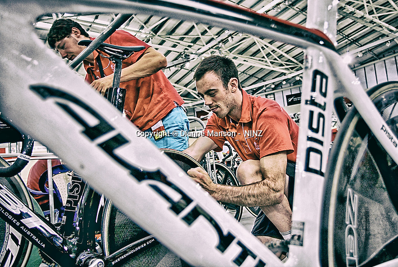 Josh Haggerty and Fabian Wybrow work on their bikes before the morning session at the BikeNZ Elite & U19 Track National Championships, Avantidrome, Home of Cycling, Cambridge, New Zealand, Sunday, March 16, 2014. Credit: Dianne Manson