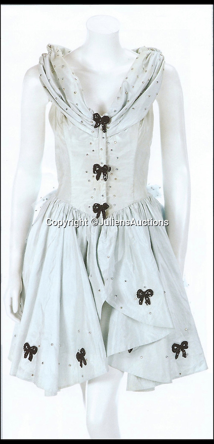BNPS.co.uk (01202 558833)<br /> Pic: JuliensAuctions/BNPS<br /> <br /> ***Please Use Full Byline***<br /> <br /> Madonna Who's That Girl tour worn dress. Est: $30,000 - 40,000. <br /> <br /> A British hedge fund company is about to cash-in on a surprisingly-secure investment - Madonna.<br /> <br /> Marquee Capital was launched in 2005 looking for investors to raise a six-figure kitty to snap up celebrity memorabilia.<br /> <br /> The organisation bought more than 140 Madonna items, mostly costumes and jewellery, she wore during her movie and singing career.<br /> <br /> The goods included dozens of outfits from the 1996 hit musical Evita as well as the star's peach baseball dress and glove from her 1992 movie 'A League of Their Own' and a vest top and jeans she wore for her music video of American Pie.<br /> <br /> The sale takes place at LA-based Julien's Auctions on November 7.