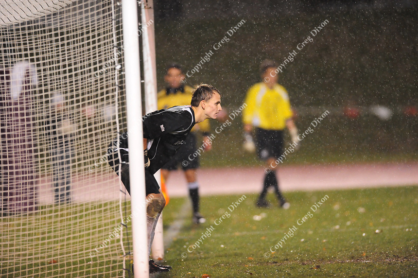Michigan goaltender, Patrick Sperry, guards the goal during the penalty shoot-out during the Big Ten playoffs against Wisconsin on Thursday at the McClimmon Soccer Complex in Madison