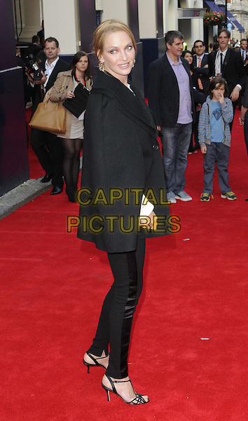 Uma Thurman<br /> 'Charlie And The Chocolate Factory' press night, Theatre Royal, Drury Lane, London, England.<br /> 25th June 2013<br /> full length black trousers cape poncho jacket white top side<br /> CAP/CAN<br /> &copy;Can Nguyen/Capital Pictures