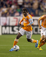 Houston Dynamo midfielder Lovel Palmer (22) brings the ball forward. The New England Revolution defeated Houston Dynamo, 1-0, at Gillette Stadium on August 14, 2010.