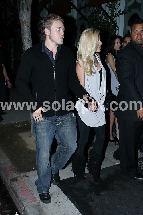 **ALL ROUND EXCLUSIVE PICTURES FROM SOLARPIX.COM**.**WORLDWIDE SYNDICATION RIGHTS**.**NO PUBLICATION IN AUSTRALIA, NEW ZEALAND, DENMARK, GERMANY OR USA**.Heidi Montag and Spencer Pratt arrive at Foxtail Lounge in West Hollywood. Hollywood, California, USA. 25th September 2008..JOB REF: 7466 LAP (JSL)       DATE: 25_09_2008 .**MUST CREDIT SOLARPIX.COM OR DOUBLE FEE WILL BE CHARGED* *UNDER NO CIRCUMSTANCES IS THIS IMAGE TO BE REPRODUCED FOR ANY ONLINE EDITION WITHOUT PRIOR PERMISSION*