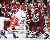 Brian Gibbons (BC - 17), Ben Rosen (BU - 8), Cam Atkinson (BC - 13), Chris Kreider (BC - 19) - The visiting Boston College Eagles defeated the Boston University Terriers 3-2 to sweep their Hockey East series on Friday, January 21, 2011, at Agganis Arena in Boston, Massachusetts.