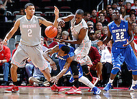Ohio State Buckeyes guard Shannon Scott (3) and Ohio State Buckeyes forward Marc Loving (2) knock the ball away from Central Connecticut State Blue Devils guard Kyle Vinales (1) in the first half of the college basketball game between the Ohio State Buckeyes and the Central Connecticut State Blue Devils at Value City Arena in Columbus, Saturday afternoon, December 7, 2013. As of half time the Ohio State Buckeyes led the Central Connecticut State Blue Devils 38 - 29. (The Columbus Dispatch / Eamon Queeney)