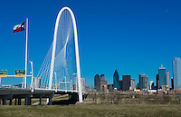 Dallas Texas new Margaret Hunt Hill Bridge white modern art structure in downtown Dallas city with skyline in background