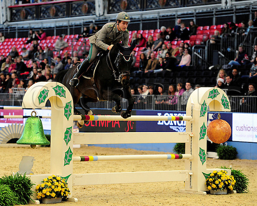 20.12.2014.  London, England. London Olympia Horse Show. The Father Christmas Stakes. Emanuele Gaudiano riding Caesario
