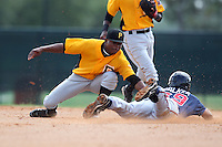 GCL Pirates second baseman Jodaneli Carajal #5 attempts to tag Kirk Walker #39 on a stolen base during a game against the GCL Braves at Disney Wide World of Sports on June 25, 2011 in Kissimmee, Florida.  The Pirates defeated the Braves 5-4 in ten innings.  (Mike Janes/Four Seam Images)