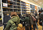 March 16, 2012, Tokyo, Japan - A herd of bargain-hunters occupies every inch of the floor space of UNIQLOs newest store opened at the Ginza shopping district in the heart of Tokyo on Friday, March 16, 2012...The mega store occupies a whole complex, stretching the retailer's merchandize from the building's ground to its 12th floor, occupying some 4,950 square meters of sales space. The new flagship store also incorporates a number of global features, including having all price tags in four different languages. Some 100 of the store's 520 employees are foreigners, who will be able to meet customers' needs in English, Korean, Chinese, Spanish and French languages. (Photo by Natsuki Sakai/AFLO) AYF -mis-.