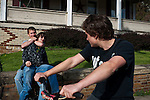 "Zanyle Hedges playfully chokes Brandon Fay on Main Street in New Straitsville, Ohio while Michael ""Roady"" Melnek watches from his bike."