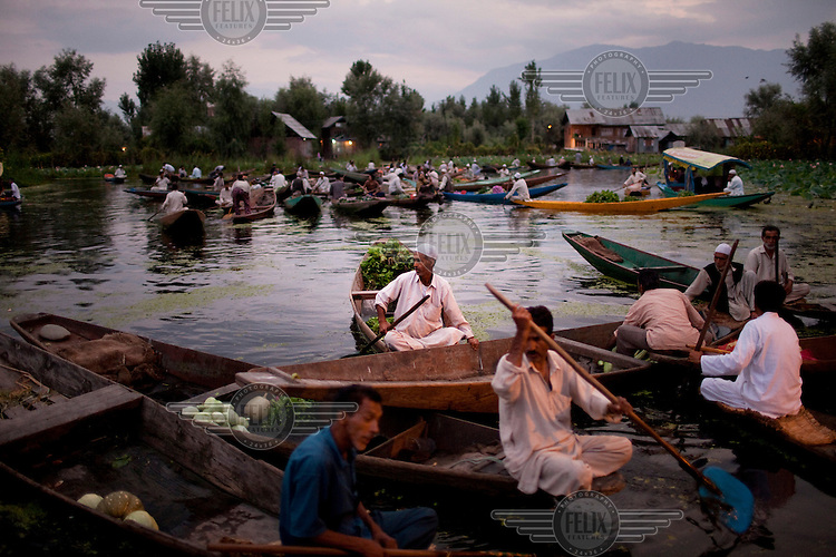 A floating market consisting of shikaras, or small wooden boats, on Lake Dal.