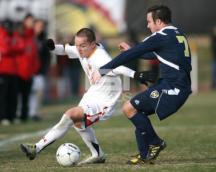 Casey Townsend #11of the University of Maryland tries to get around Chase Tennant #7 of the University of Michigan during an NCAA quarter-final match at Ludwig Field, University of Maryland, College Park, Maryland on December 4 2010.Michigan won 3-2 AET.