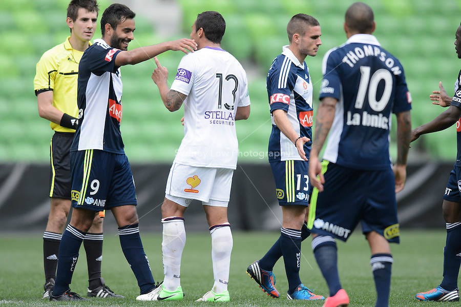MELBOURNE - 19 September: Marco FLORES of the Victory and Travis DODD of the Glory share a moment after a pre-season match between Melbourne Victory and Perth Glory at AAMI Stadium on 19 September 2012. (Photo by Sydney Low / syd-low.com)