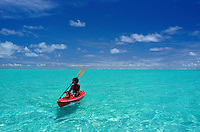 A red kayak cruising Inside the lagoon in Yap Micronesia