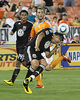 Pablo Hernandez #21 of D.C. United heads the ball away from Brad Davis #11 of the Houston Dynamo during an MLS match at RFK Stadium in Washington D.C. on September  25 2010. Houston won 3-1.
