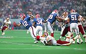 Washington Redskins defensive end Fred Stokes (60) sacks Buffalo Bills quarterback Jim Kelly (12) during Super Bowl XXVI in Minneapolis, Minnesota on January 26, 1992.  The Redskins won the game and the World Championship 37 - 24.<br /> Credit: Arnie Sachs / CNP