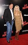 HOLLYWOOD, CA. - March 11: Actor Robert Hays and musician Cherie Currie arrive at the Los Angeles Premiere of The Runaways at ArcLight Cinemas Cinerama Dome on March 11, 2010 in Hollywood, California.