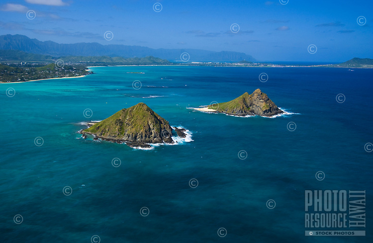 Aerial of the Moku Lua islands of the coast of Lanikai, Kailua, windward Oahu