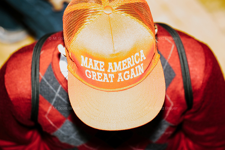 "A person wears a hat reading ""Make America Great Again"" after real estate mogul and Republican presidential candidate Donald Trump spoke at a rally at Exeter Town Hall in Exeter, New Hampshire, on Thurs., Feb. 4, 2016."