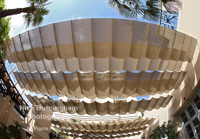 An elaborate sun shade keeps diners cool in the Plaza de las Fuentes, Pasadena, CA seen through a fisheye lens
