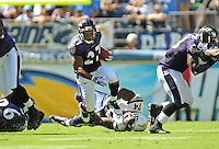 Sep. 20, 2009; San Diego, CA, USA; Baltimore Ravens running back (27) Ray Rice breaks the tackle of San Diego Chargers defensive end (74) Jacques Cesaire at Qualcomm Stadium in San Diego. Baltimore defeated San Diego 31-26. Mandatory Credit: Mark J. Rebilas-