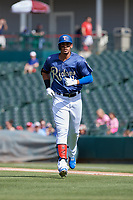 Frisco RoughRiders Ronald Guzman (11) during a Texas League game against the Springfield Cardinals on May 5, 2019 at Dr Pepper Ballpark in Frisco, Texas.  (Mike Augustin/Four Seam Images)