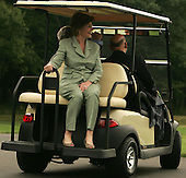 Camp David, MD - August 5, 2007 -- First lady Laura Bush holds on as United States President George W. Bush gives President Hamid Karzai of Afghanistan a ride in a VIP golfcart at Camp David, Maryland on Sunday, August 5, 2007..Credit: Dennis Brack - Pool via CNP