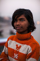 Nitu, 13, poses for a portrait on the Boat School Guria runs on the holy Ganges River, in Varanasi, Uttar Pradesh, India on 19 November 2013. The school, accommodating almost 50 children, aims to take the boatmen's children away from working in the tourist areas where they are exposed to trafficking and sexual abuse.