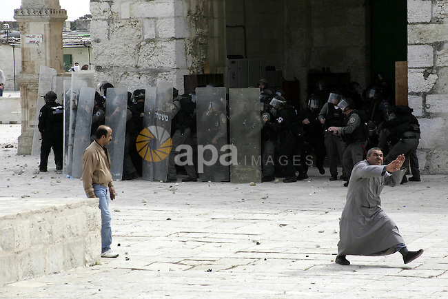 Palestinians throw stones at the Israeli soldiers during clashes on the compound known to Muslims as al-Haram al-Sharif and to Jews as the Temple Mount in Jerusalem's Old City March 5, 2010. Israeli police and Palestinians clashed near Jerusalem's flashpoint al-Aqsa mosque on Friday and about 30 people were injured, Israeli police and Palestinian medical workers said . Photo by Mohamar Awad