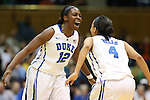 11 February 2013: Duke's Chelsea Gray (12) and Chloe Wells (4) celebrate a fast break. The Duke University Blue Devils played the University of Maryland Terrapins at Cameron Indoor Stadium in Durham, North Carolina in an NCAA Division I Women's Basketball game. Duke won the game 71-56.