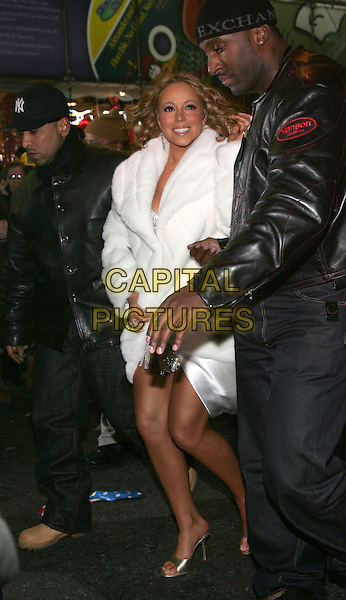 MARIAH CAREY.New Year's Eve 2006 at Times Square, NYC, New York, NY.January 1st, 2006.Photo: Jackson Lee/Admedia/Capital Pictures.Ref: JL/ADM.full length white fur coat minder security.www.capitalpictures.com.sales@capitalpictures.com.© Capital Pictures.