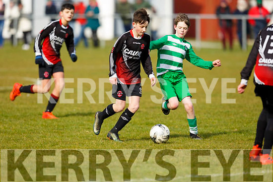 Sean McElligott of St Brendans Park under pressure from Killarneys Mark Daly in the John Joe Naughton U13's Cup game, in Christy Leahy Park on Saturday last.