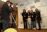 SIOUX FALLS, SD - MARCH 30: Gene Simmons from KISS and Vince Neil from Motley Crue pose for photos with Chuck and Mary Brennan and their son Jet at the grand opening of the Brennan Rock and Roll Academy Saturday March 30, 2013 in Sioux Falls, SD. (Photo by Dave Eggen/Inertia)