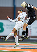 NWA Democrat-Gazette/JASON IVESTER --03/20/2015--<br /> Rogers Heritage sophomore Erol Banuelos (cq) (left) and Bentonville senior Ryan Bray go up for a header during the first half on Friday, March 20, 2015, at David Gates Stadium in Rogers.