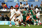 14 June 2006: Jaouhar Mnari (TUN) (left) beats Yaser Al Kahtani (KSA) (20) to the ball. Tunisia tied Saudi Arabia 2-2 at the Allianz Arena in Munich, Germany in match 16, a Group H first round game, of the 2006 FIFA World Cup.