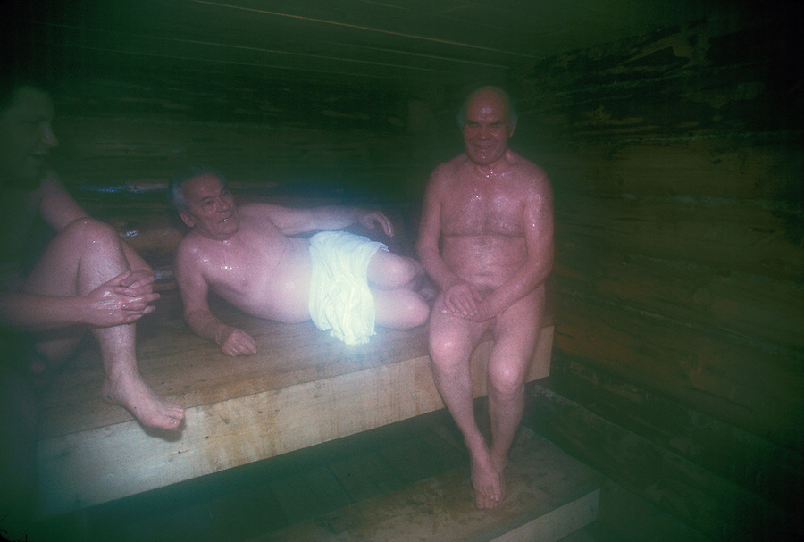 Izhevsk, Siberia, Russia, 10/11/1993.<br /> Weapons inventor Mikhail Kalashnikov [centre] in the banya during a hunting trip for deer, moose and elk on his birthday.