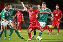 Northern Ireland's Jonathan Evans (L) and Northern Ireland's Steven Davis (R) blocks Portugal's Bruno Aives during a World Cup Qualifier in Belfast, Friday September 6th, 2013.  Photo/Paul McErlane