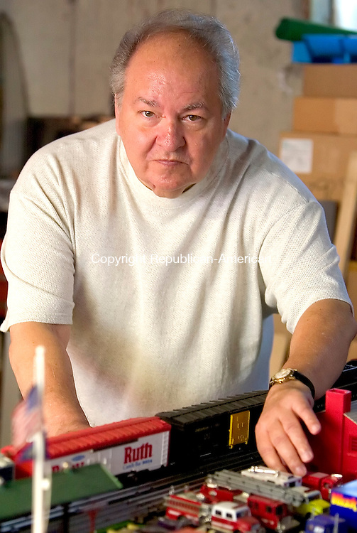 NAUGATUCK, CT. 03 May 2007-050307SV03--William Bush works with his train collection he has been collecting for more than 40 years at his home in Naugatuck Thursday. Bush, a 60-year-old man from Naugatuck, was diagnosed with breast cancer three years ago. Men make up less than 1 percent of breast cancer cases.<br /> Steven Valenti Republican-American