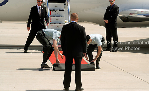 Security and Air Force personnel put the red carpet for the arrival of Prime Minister of Canada April 12, 2010 at Andrews Air Force Base in Maryland. Leaders from around the world including nuclear powers are meeting in Washington this week for a two-day nuclear security summit.  .Credit: Olivier Douliery / Pool via CNP