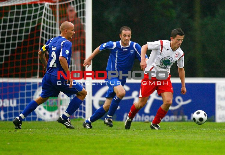 NFV-Pokal Achtelfinale<br /> Dennis-Matthias Brode (Eintracht Nordhorn #9) - Jasmin Spahic (Kickers Emden BIH #15), links: Rudolf Zedi (Kickers Emden GER #25)<br /> Foto &copy; nph (  nordphoto  )<br /> <br /> <br /> <br />  *** Local Caption ***