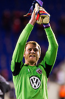 D. C. United goalkeeper Joe Willis (31) salutes the fans after the match. D. C. United defeated the New York Red Bulls 1-0 (2-1 in aggregate) during the second leg of the MLS Eastern Conference Semifinals at Red Bull Arena in Harrison, NJ, on November 8, 2012.