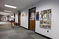 A student walks past the SIU Service Center located within Shawnee Community College in Ullin, Ill., on Wednesday, July 13, 2011. Seven SIU Service Centers such as this one have partnered with Illinois state community colleges in a pilot program where students in the program will apply and be accepted at the four-year institution, but complete their first two years at the community college.