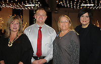NWA Democrat-Gazette/CARIN SCHOPPMEYER Carrie Davis (from left), Tyler Benson, Doris Baldwin, Peace at Home board members and Teresa Mills, executive director, welcome supporters to the Courage Award Luncheon.