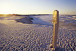 Ice covers a signpost on the shore of Prince Edward Island's Cavendish National Park, Canada. Winter often means that the Gulf of St. Lawrence is covered in ice.