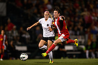 Western New York Flash forward Abby Wambach (20) is fouled by Portland Thorns defender Kat Williamson (5). The Portland Thorns defeated the Western New York Flash 2-0 during the National Women's Soccer League (NWSL) finals at Sahlen's Stadium in Rochester, NY, on August 31, 2013.