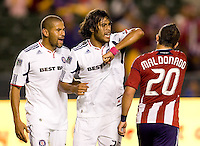 Chicago Fire players C.J. Brown (l-w) and Wilman Conde (r-w) throwing his elbow at Chivas USA forward Giancarlo Maldonado (20). The Chicago Fire defeated CD Chivas USA 3-1 at Home Depot Center stadium in Carson, California on Saturday October 23, 2010.