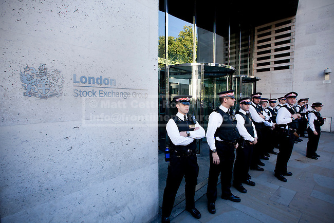 15/10/2011. LONDON, UK. City of London Police guard an entrance to the London Stock Exchange during the Occupy London protest.As part of an anti-capitalist protest taking place in cities across the globe, demonstrators attempt to occupy Paternoster Square in London under the name Occupy London Stock Exchange.  After being refused entry to the square itself thousands of protesters occupied the area outside St Paul's Cathedral with some erecting tents. Credit should read: Matt Cetti-Roberts