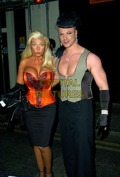 LEA WALKER & RICHARD NEWMAN .The Devaux Burlesque Party, Jewel Maiden Lane, London, England..September 11th, 2007.Big Brother 7 full length black skirt corset basque cleavage lingerie red gloves waistcoat hat veil makeup make-up make up trousers .CAP/CAN.©Can Nguyen/Capital Pictures