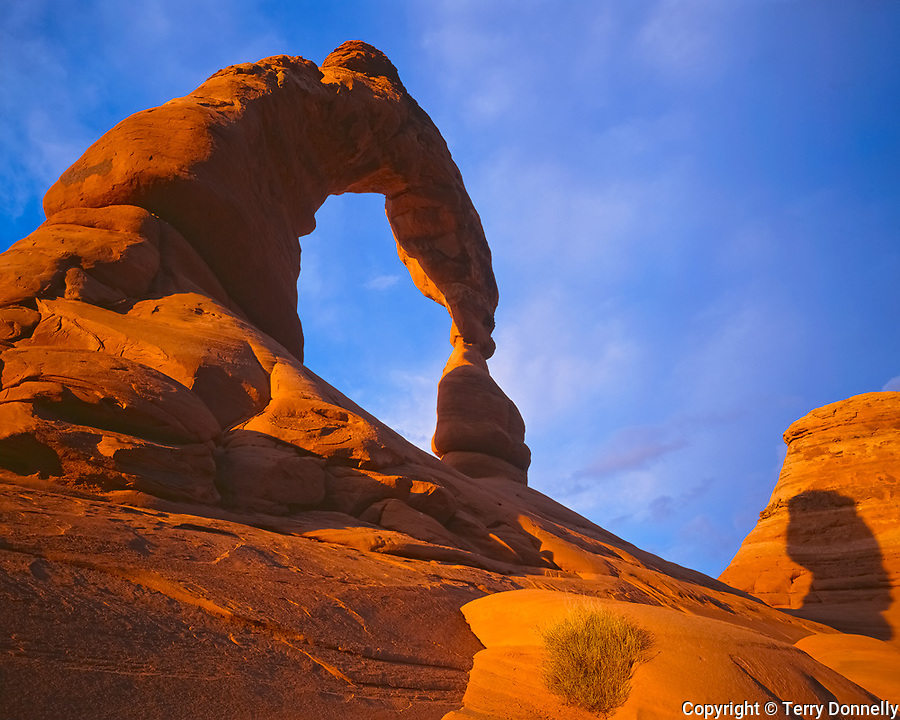 Arches National Park, UT<br /> South face of Delicate Arch in gold sunset light